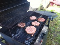 Fresh ground goat patties on the grill